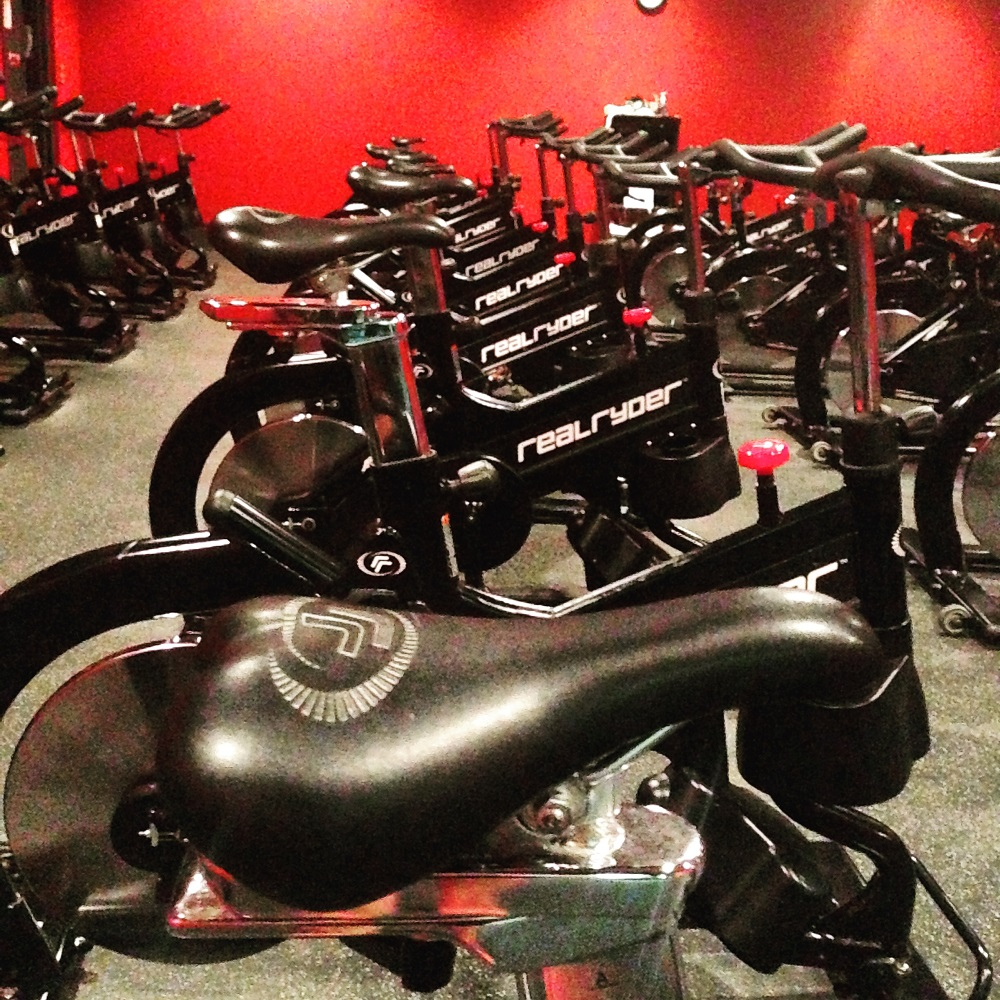 Spin bikes sitting empty and waiting for the next class to begin